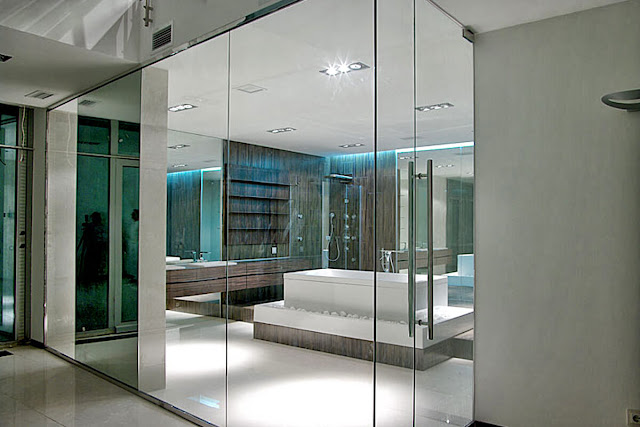 Glass partition with sandblasting elements