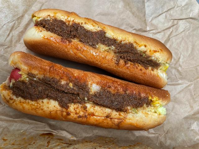 Two Bull Dogs: mustard, slaw, chili, onions
