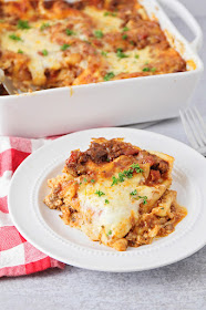 This delicious lasagna is truly the best! The recipe makes two pans, so it's easy to bake one and put another in the freezer for later!