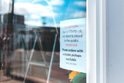 Coronavirus Service Sign at The Doghouse in St. John's - Source: Erik Mclean via Unsplash - https://unsplash.com/photos/0zxe8y3iVa8