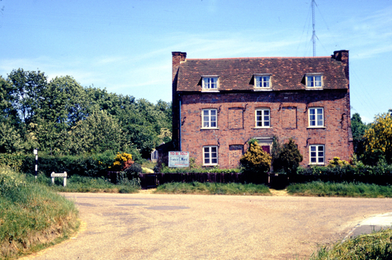 Photograph of The Georgian house that stood in Bell Lane, Bell Bar opposite Bulls Lane 1962. The smithy was located behind. Image from Ron Kingdon, part of the Images Of North Mymms Collection