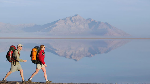 Couple hiking along lakeside