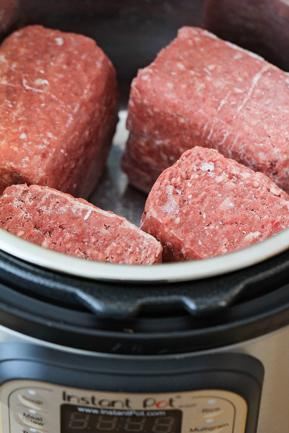 Forgot to thaw ground beef for dinner? No worries - just throw it in the Instant Pot! It's so quick and easy, and makes perfect ground beef!