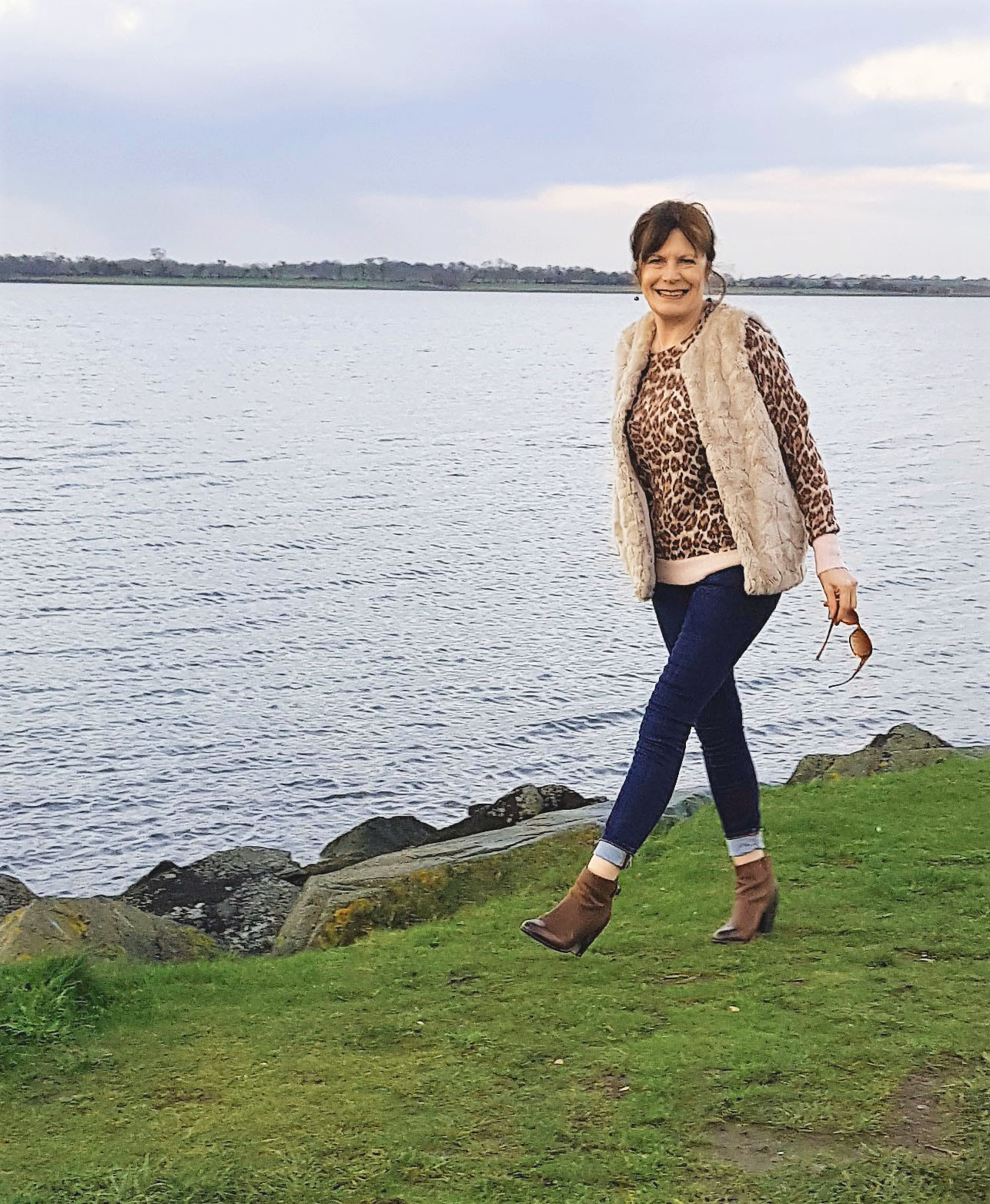 Over 50s blogger Over The Hilda against dramatic backdrop wearing jeans and leopard print for the Style Not Age challenge