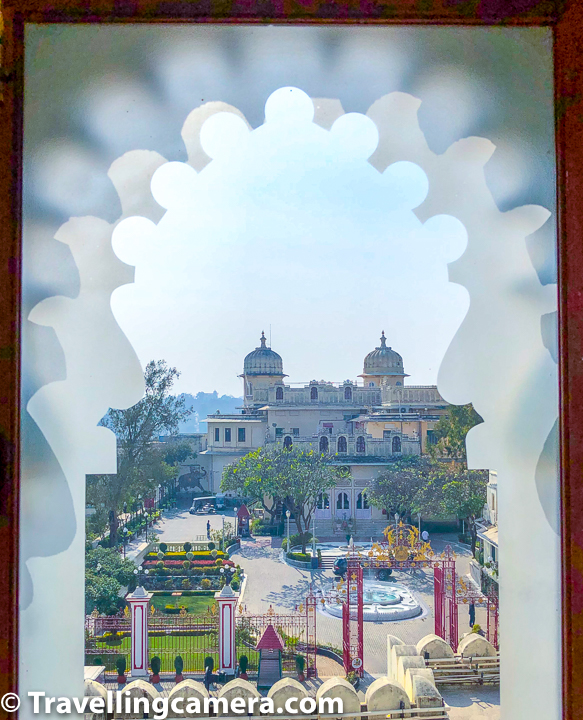 Above photograph shows the part of Udaipur City Palace where royal family lives. Arvind Singh Mewar along with his family live in the palace you see above. This photograph is clicked through one of the windows where musical instruments are showcases in City palace of Udaipur.