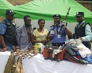 Nursing mother apprehended with AK47 rifle in her traveling bag, says her husband gave the bag to her (photo)