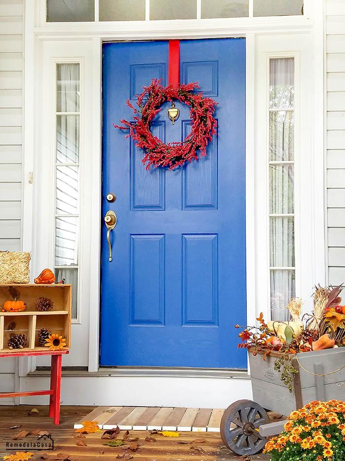 BLUE door, pine cone display, mums, pumpkins