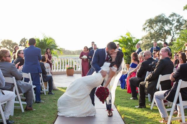 groom kisses bride after ceremony
