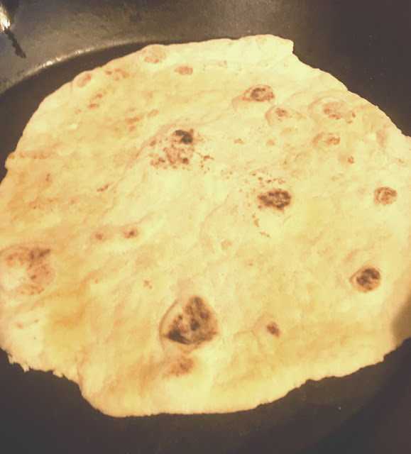 Flatbread cooking in cast iron pan