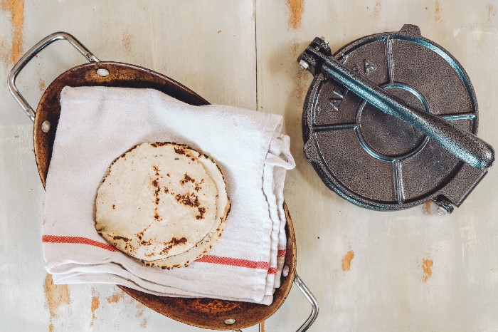 Homemade Corn Tortillas with corn press