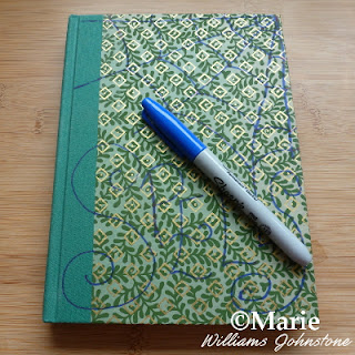 Sharpie pen and hard cover notebook