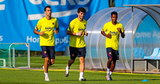 Picture of Ansu Fati and Sergio Busquets training as they cut vacations short