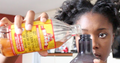 African American diabetic drinking apple cidar vinegar