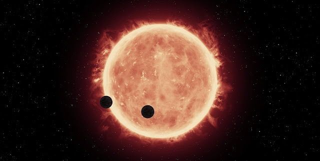 This artist's illustration shows two Earth-sized planets, TRAPPIST-1b and TRAPPIST-1c, passing in front of their parent red dwarf star, which is much smaller and cooler than our sun. NASA's Hubble Space Telescope looked for signs of atmospheres around these planets. Credits: NASA/ESA/STScI/J. de Wit (MIT)