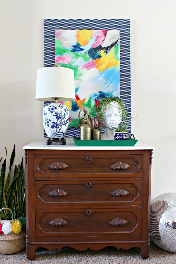 vintage dresser, marble top, blue and white lamp, styling, vignette, abstract art, layered canvas artwork