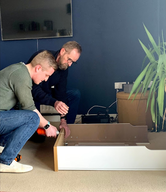 men building flat pack furniture