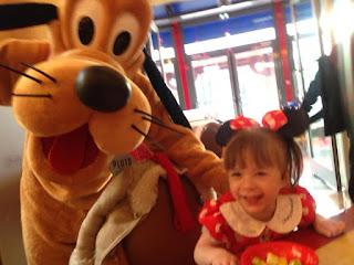 Meeting Pluto at Café Mickey Disneyland Paris