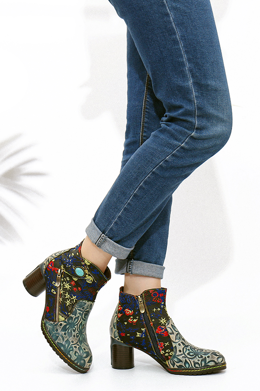 a close up picture of an ankle boots with a trendy embroidery