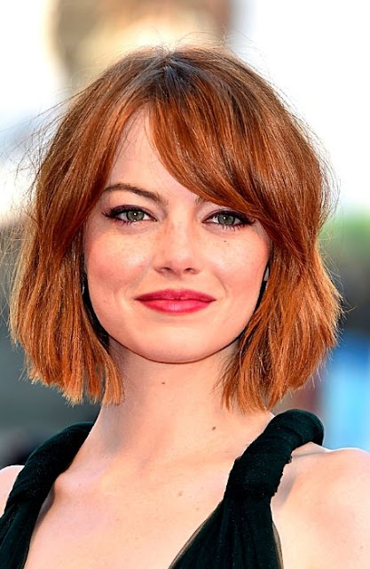 Side- Swept Wavy Hairstyle - Best Hairstyle For Round Face Women