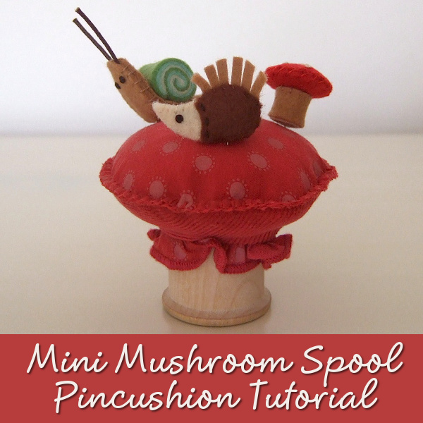 Easy, beginner mushroom toadstool wooden thread spool cotton reel pincushion tutorial craft shown with felt woodland pins snail hedgehog
