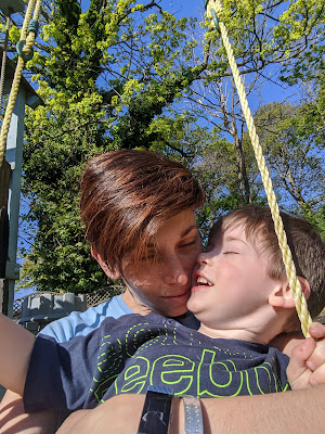 Sitting on swing with child