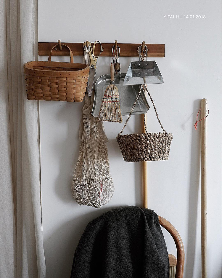INSTAGRAM CRUSH: Yitai Hu. Cleaning tools hung on a peg rail