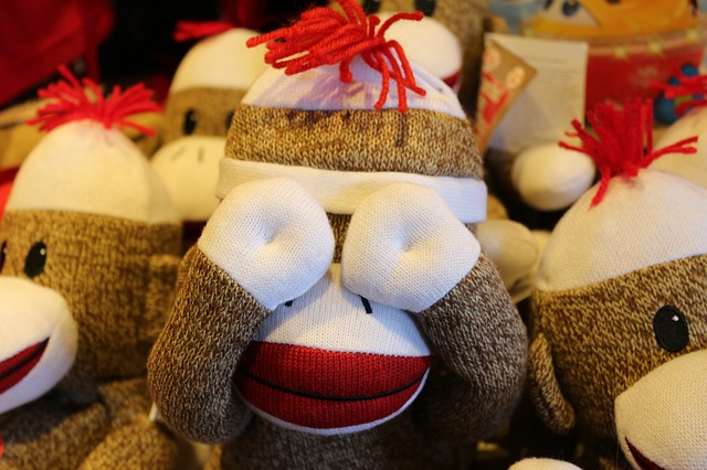 Stuffed Monkey Covering His Eyes