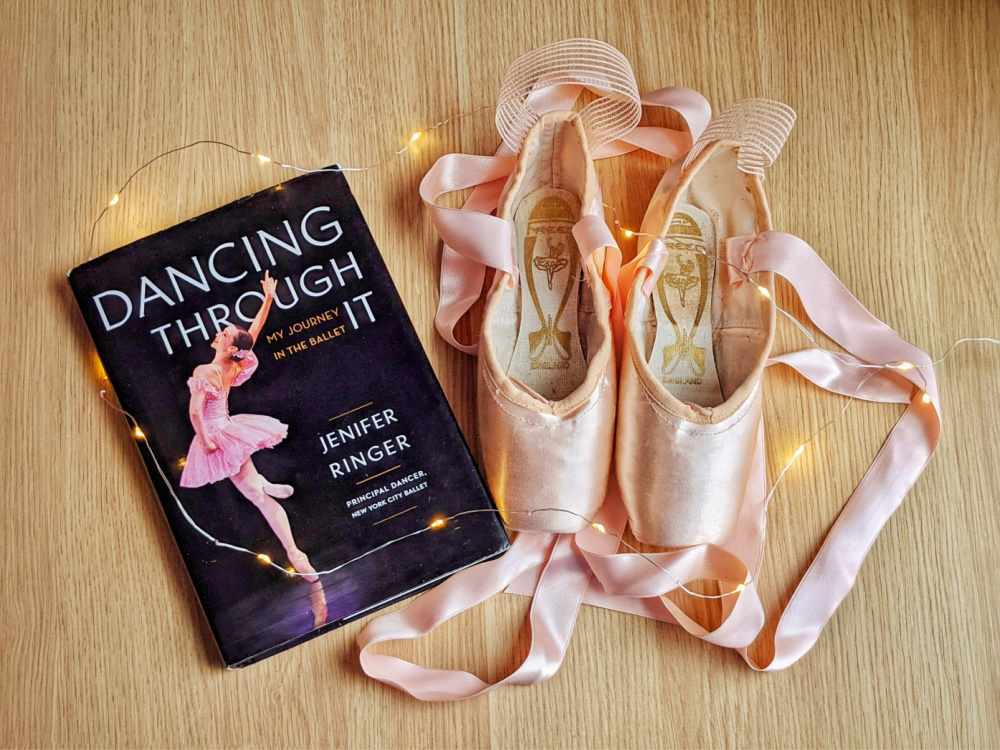 Autobiography Dancing Through It by Jenifer Ringer, fairy lights, and pointe shoes.
