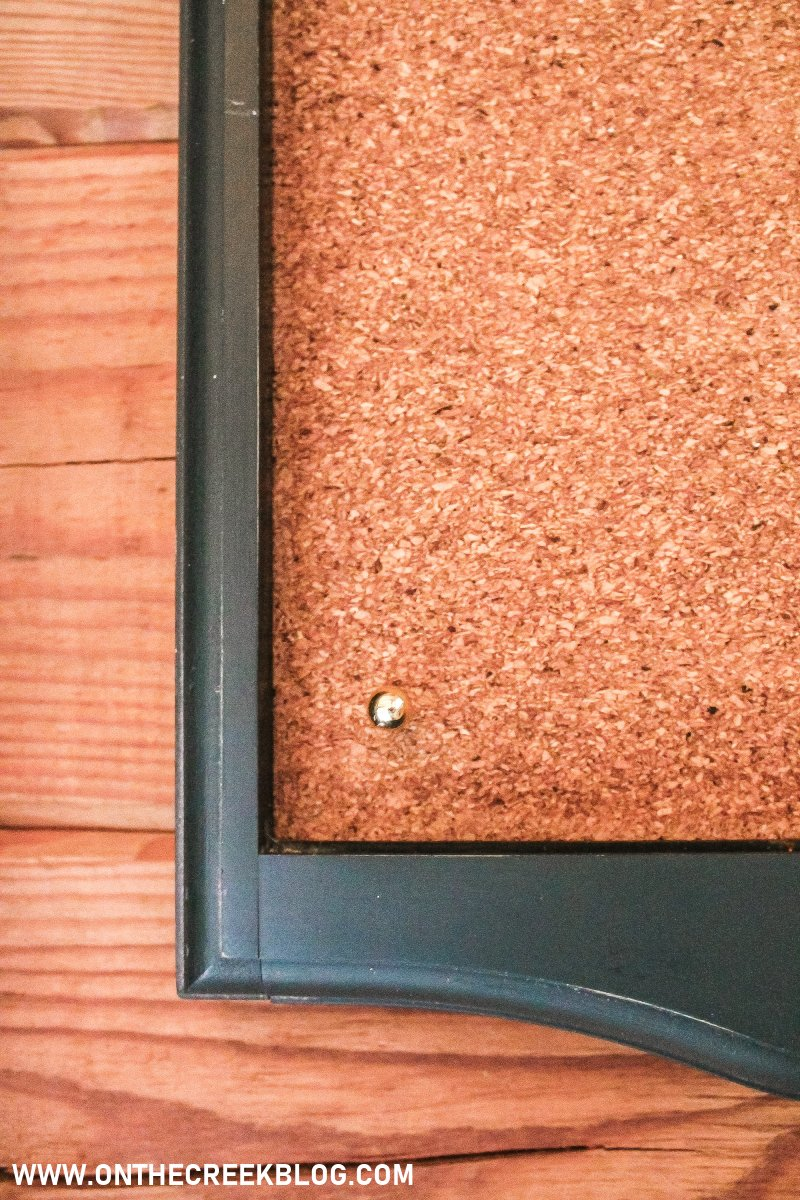 Super easy DIY bulletin/cork board using cork board roll! Gold push pins are from Meijer | On The Creek Blog