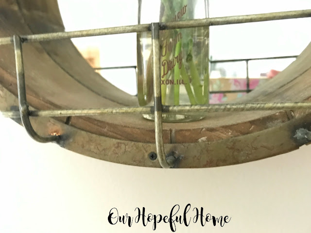 round wooden farmhouse mirror wire cage vintage milk bottle vase fresh cut flowers