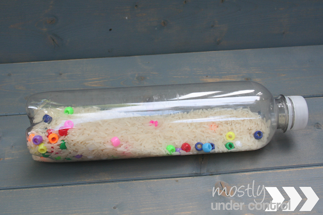 sensory bottle with rice and colorful pony beads