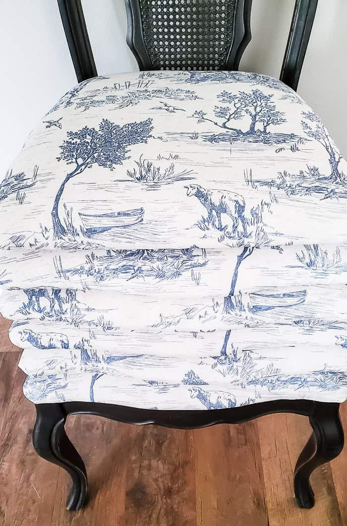 blue toile fabric on dining seats