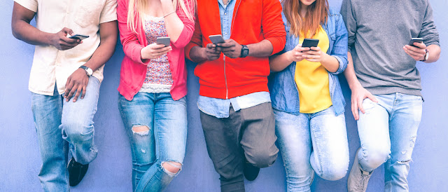 young people on a mobile