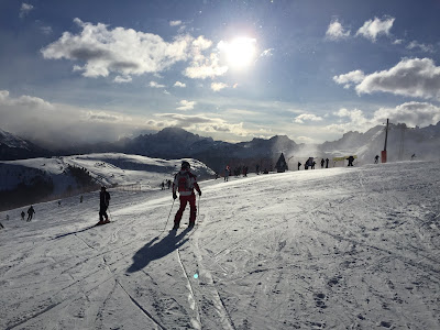 Skiing on the slopes east of Sella Massif, north of Arabba, with a view south.