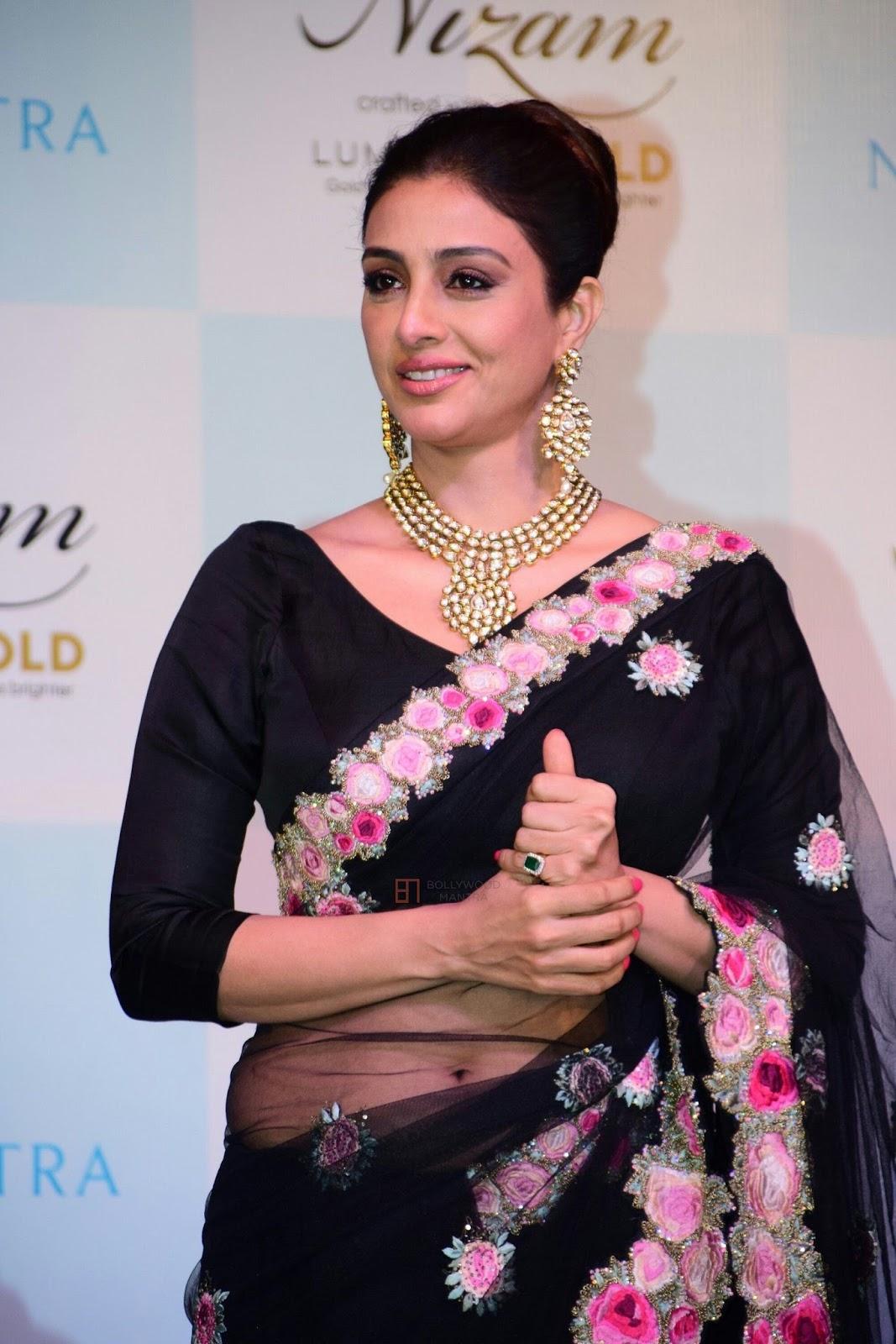 Nutabu Spanish Porn actress tabu navel show in black transparent saree