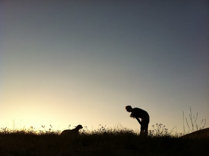 Dog Photos: Silhouette of Dog and Woman on Hill - Notes from the Pack