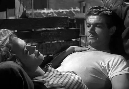 Anna Gaylor and Stephen Boyd in Seven Thunders, 1957