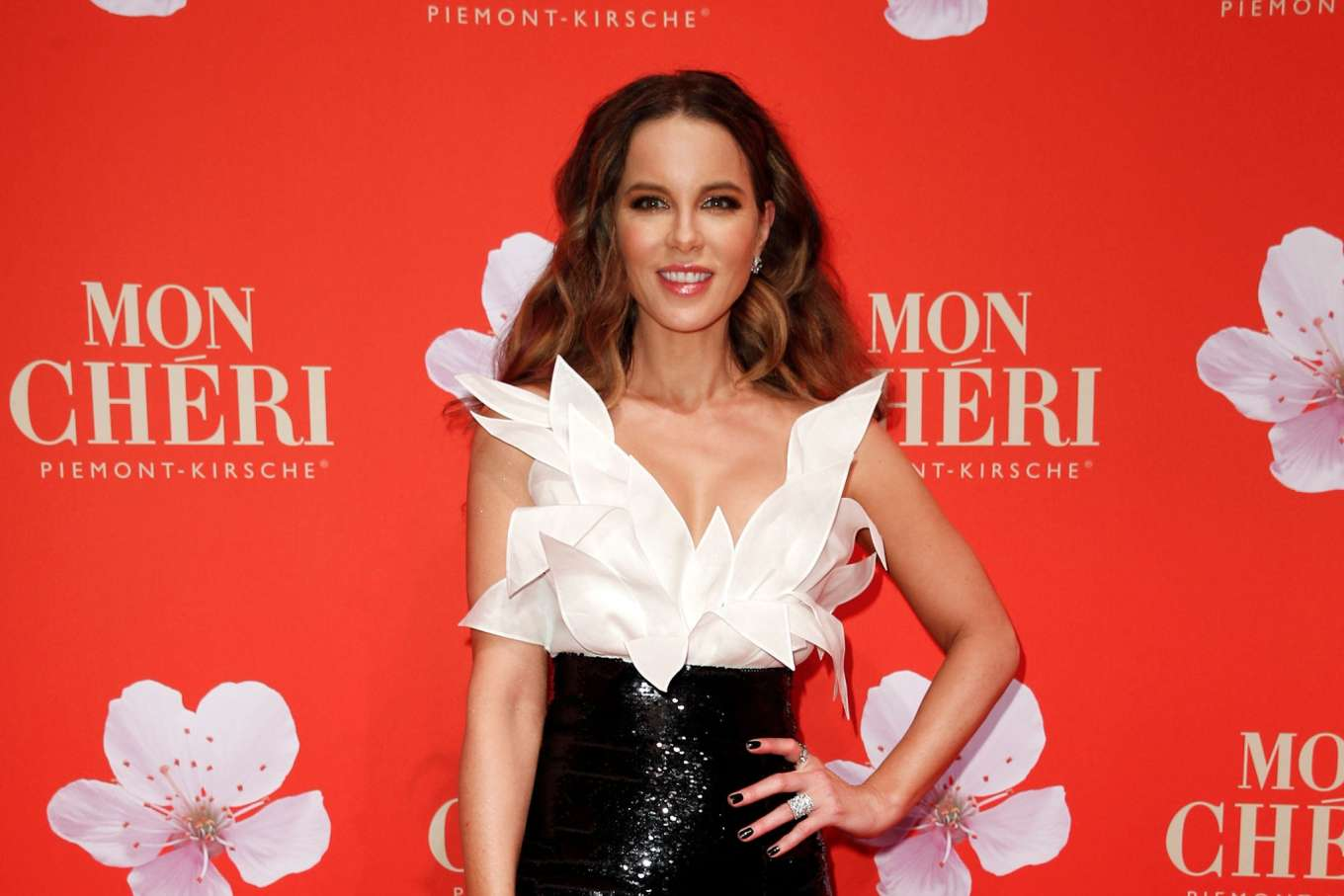 Kate Beckinsale arrives at Munich ball clad in glamorous cleavage baring gown with thigh high split