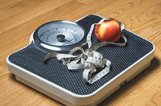 mengurangi berat badan