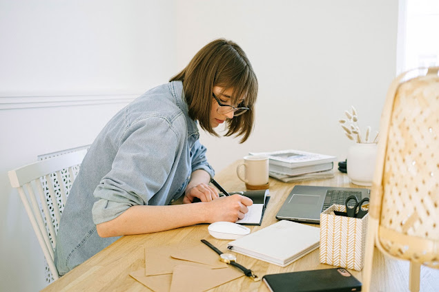 https://www.pexels.com/photo/woman-writing-on-a-notebook-4240571/
