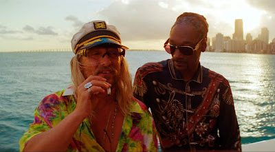 Movie still for Harmony Korine's 2019 film The Beach Bum Matthew McConaughey and Snoop Dogg smoke marijuana on a boat out at sea