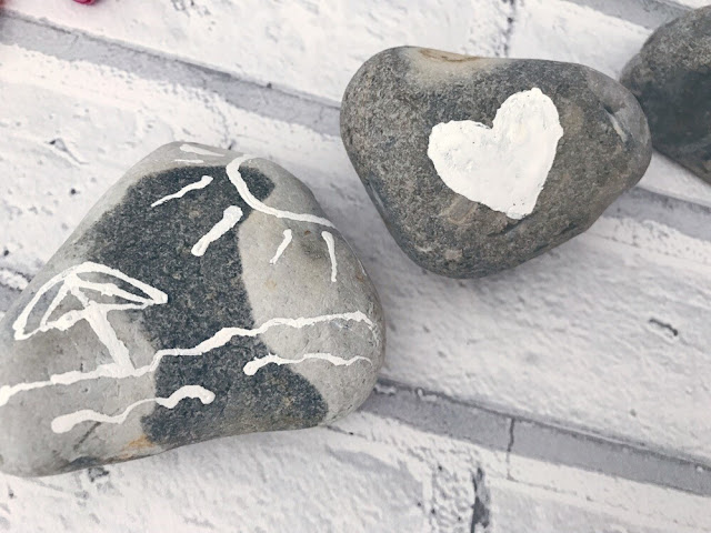 Rocks decorated with tippex/correct fluid
