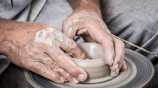 hands working in clay