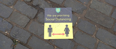 Social distancing sign in Abingdon's Market Place