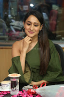 Pragya Jaiswal in a single Sleeves Off Shoulder Green Top Black Leggings promoting JJN Movie at Radio City 10.08.2017 029.JPG