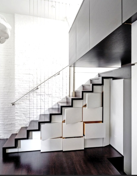 wood stair case with white storage boxes to increase space