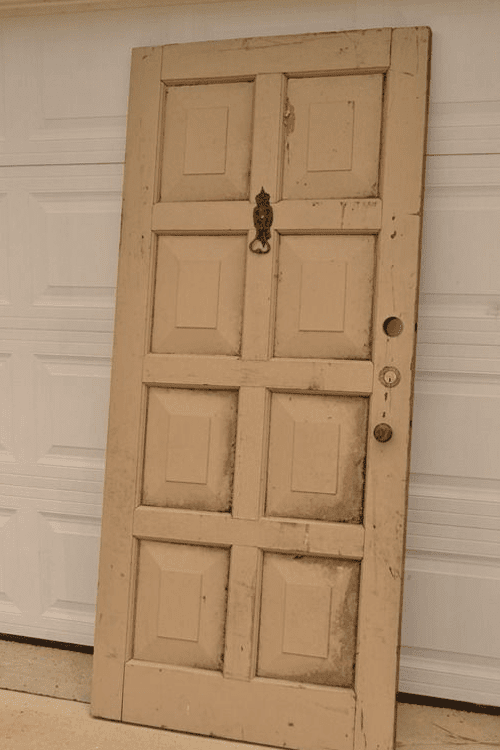 How to repurpose an old door into a bed frame handy diy for How to make a headboard out of a door