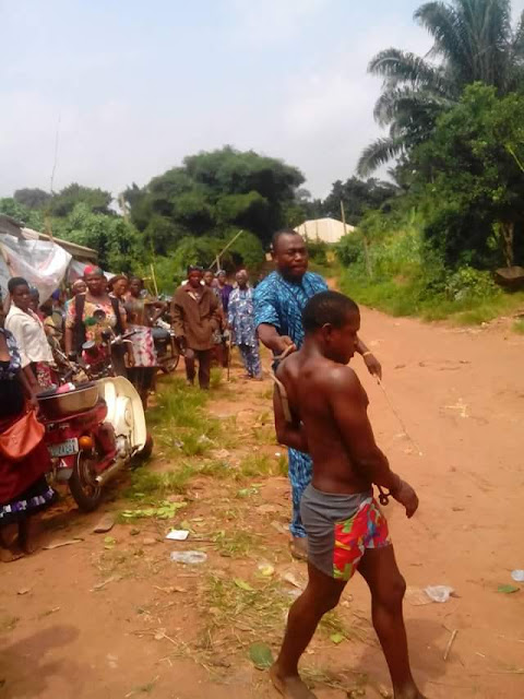 Young man beaten, paraded for stealing two crates of beer in Anambra (photos)