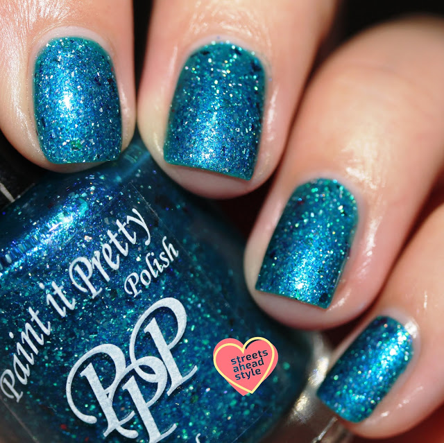 Tropical blue nail polish with holo flakes and multicolored flakes