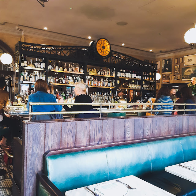the bar inside the ivy market grill in covent garden,